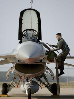 F-16 Pilot climbing into cockpit